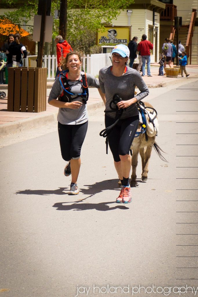 Coming into the finish line of a burro race in Georgetown, CO with Adair. The burro was named Winkie. Photo courtesy Jay Holland