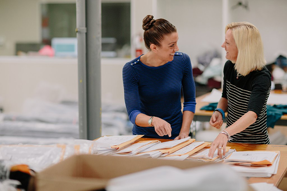 Jill (left) and Monica (right) review their apparel before production