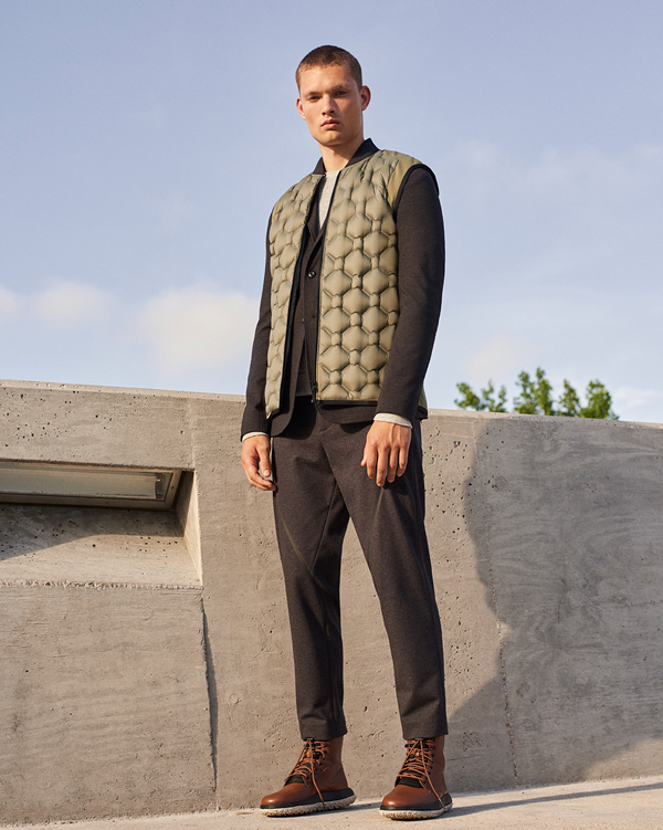 Wearing: Men's Transition Insulated Vest, Draftday Tailored Sportcoat, Rugby Suit Pants, RLT Boots.
