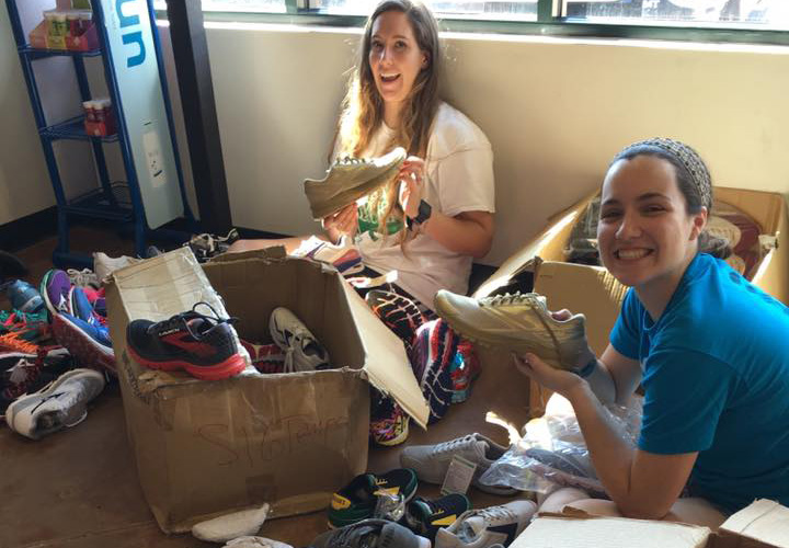 Employees Alicia Kragthorpe and Alex Hayes sorting shoes