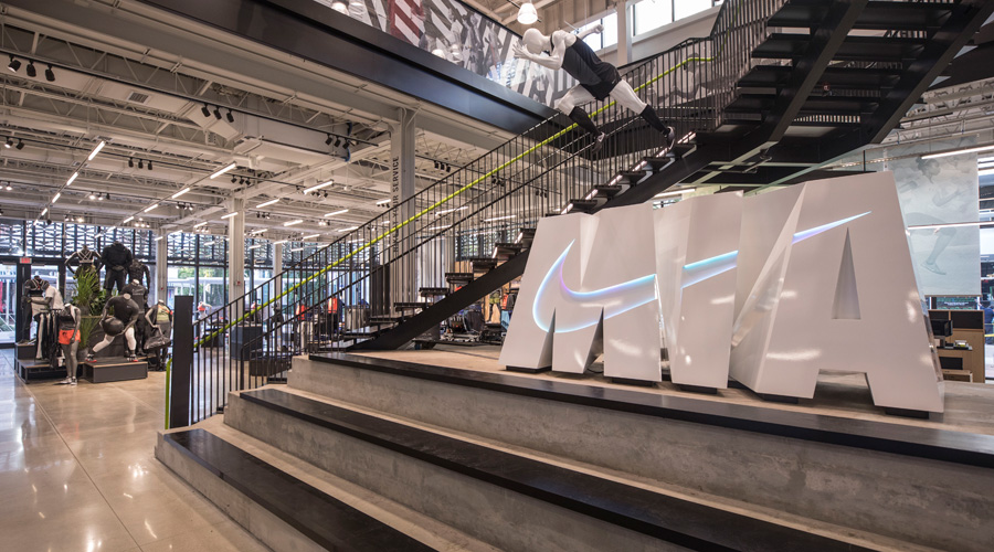 Light To The Interior Of Store While Casting Shade Outside Building Exterior Concrete And Terrazzo Panels Created By Nike Retail Design